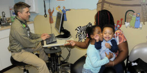 Dr. Gregory Anderson, MD with patients in the pediatric suite.