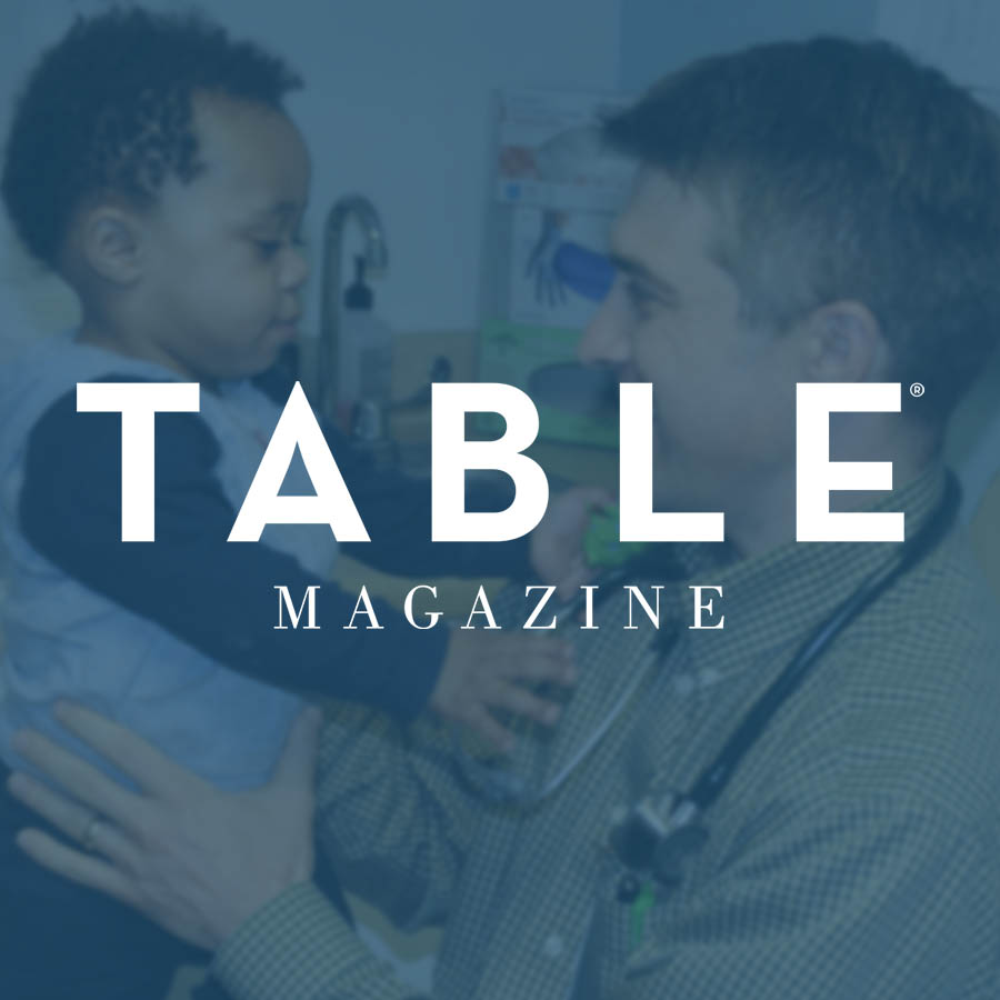Table Magazine logo over an image of ELFHCC Pediatric Doctor, Dr. Gregory Anderson