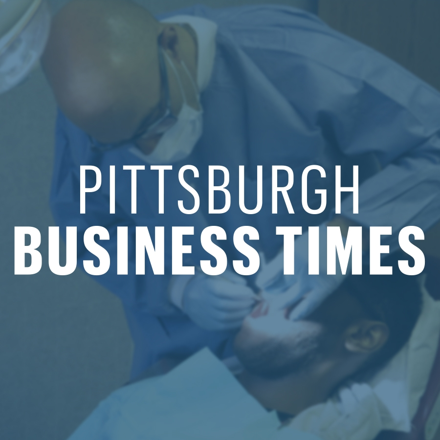 Pittsburgh Business Times logo over an image of a man receiving dental services