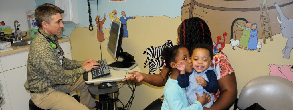 Mother and her children in ELFHCC's pediatrics suite